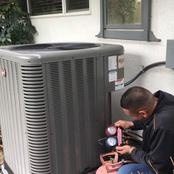 Cencal Mechanical Heating & Air employee servicing HVAC unit