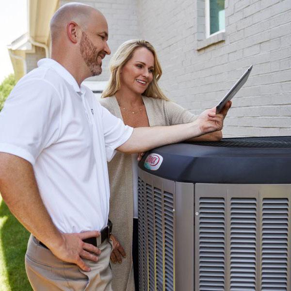 Technician showing customer new AC installation