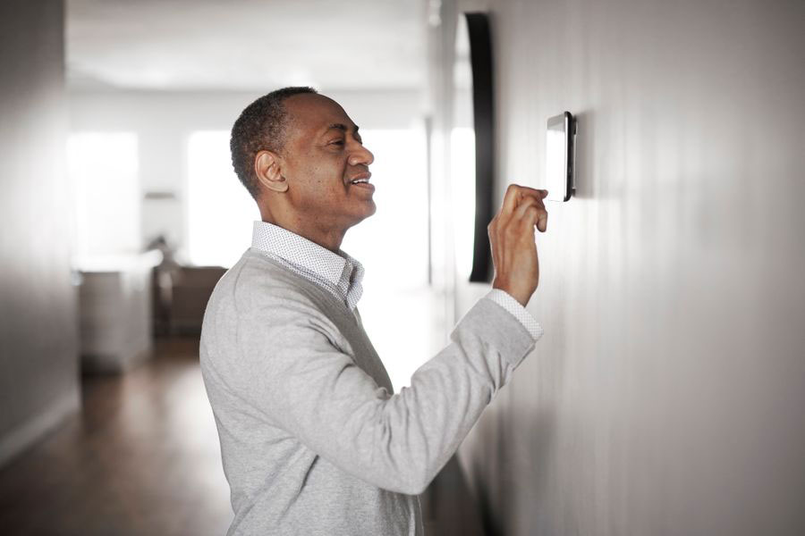 Gentleman working programmable thermostat