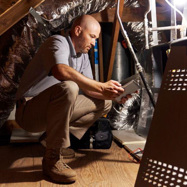 Technician repairing heater