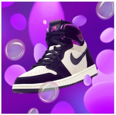 a purple background with magenta bubbles with the Air Jordan nike hightop that is white with purple details and Nike swoosh