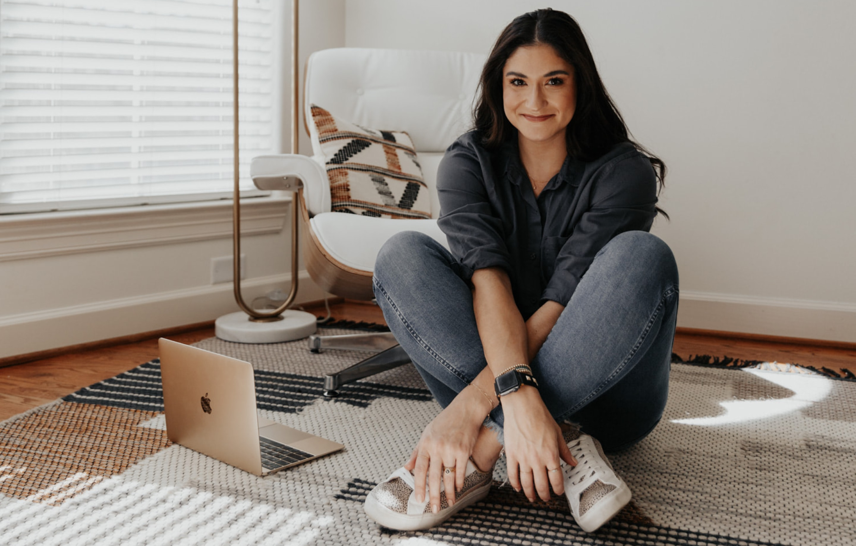 Berit sitting cross-legged on the floor