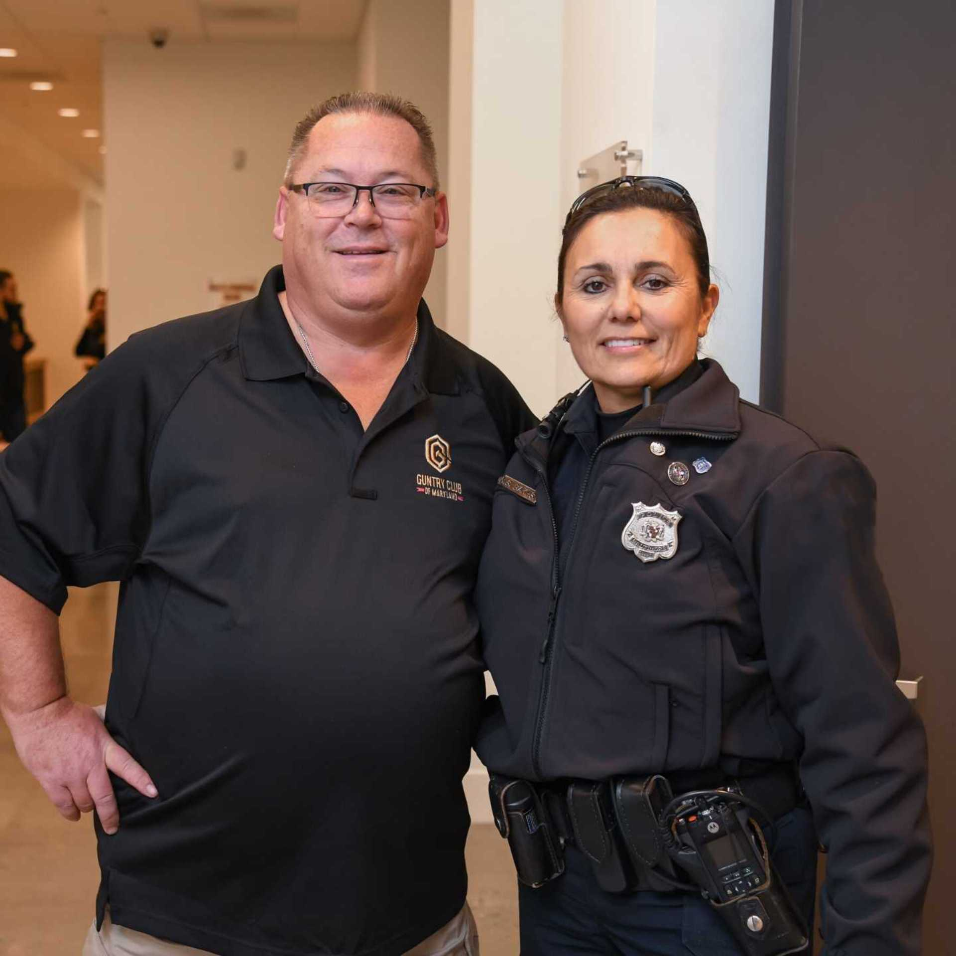 female-cop-with-guntry-employee-smiling