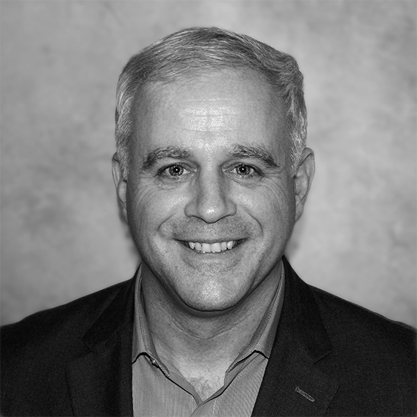 A headshot photograph of Mark Butler.