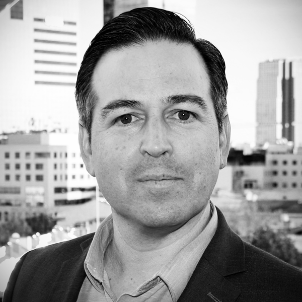 A headshot photograph of Enrique Oti.