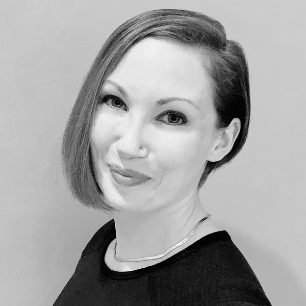 A headshot photograph of Caitlin Bowers.