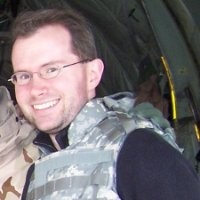 A headshot photograph of Dr. David Bray.