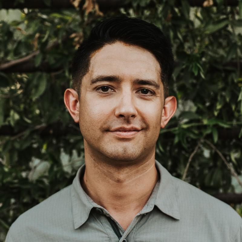 A headshot photograph of Austin Walne.