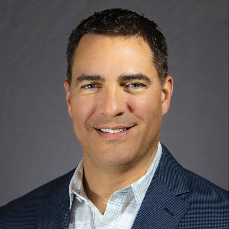 A headshot photograph of Dr. Aaron Hansen.