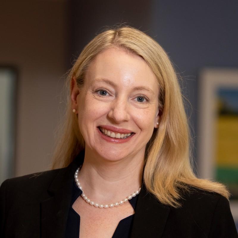 A headshot photograph of Dr. Gigi Gronvall.