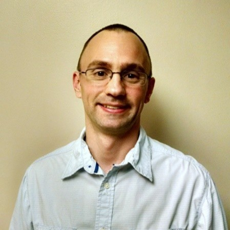 A headshot photograph of Dr. Ryan Kappedal.