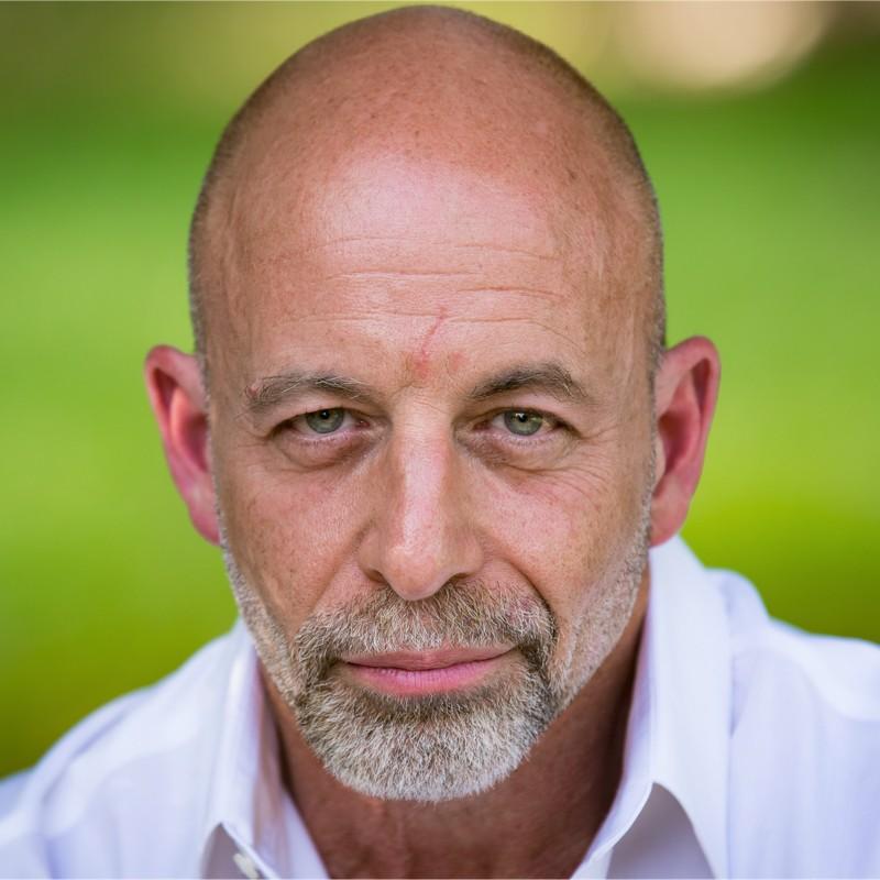 A headshot photograph of Dr. Jim Giordano.