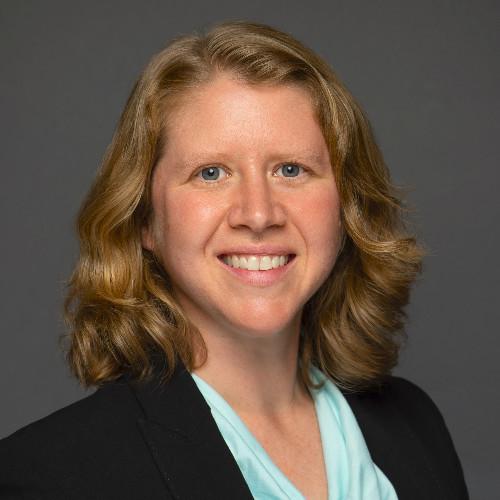 A headshot photograph of Dr. Sarah Carter.