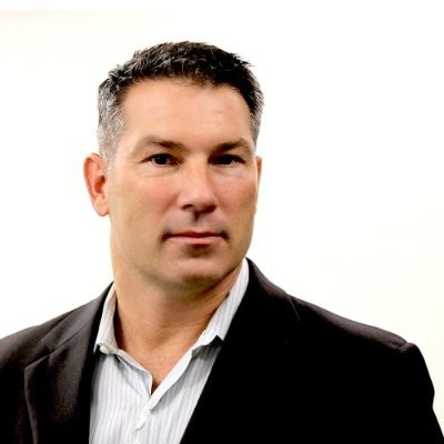A headshot photograph of Patrick Scannell.
