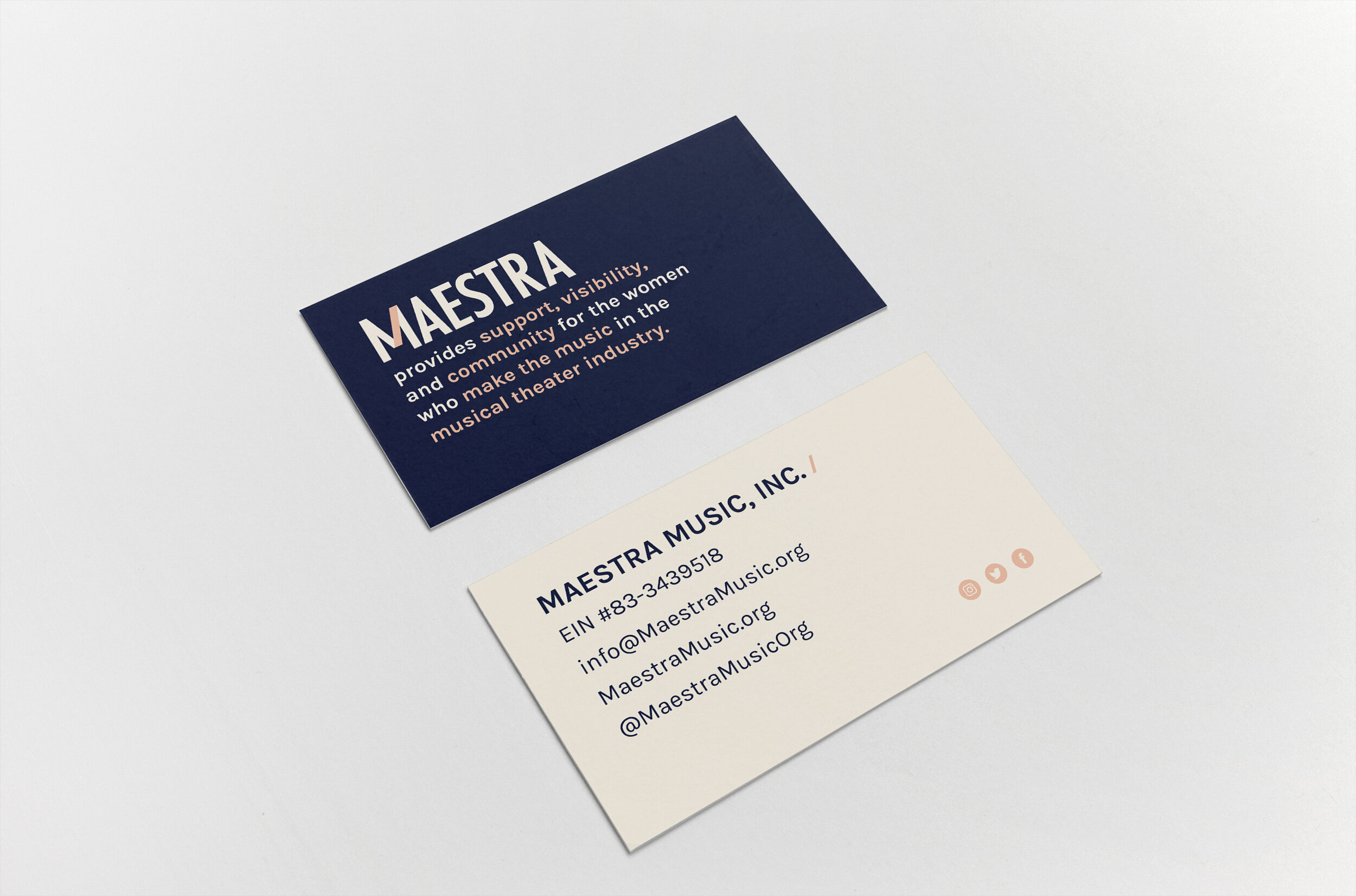 Two business cards on a grey background