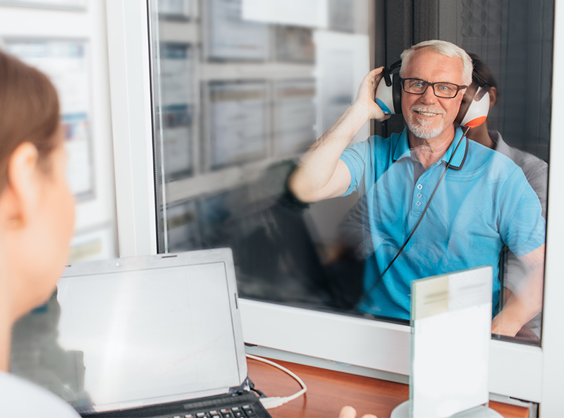 Old man wearing hearing aid