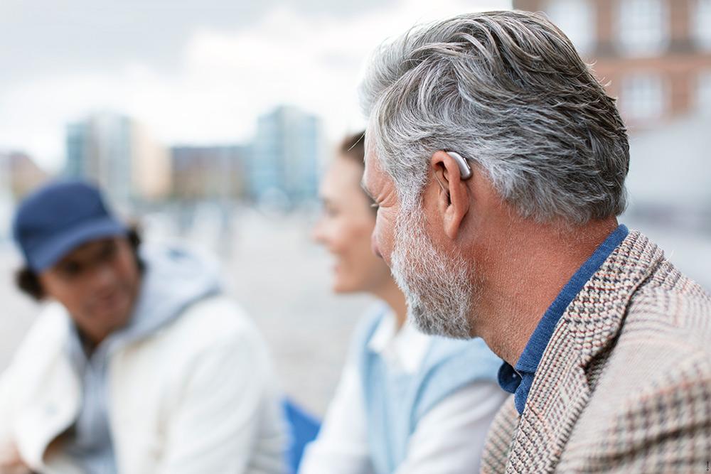 Old man wearing an hearing aid