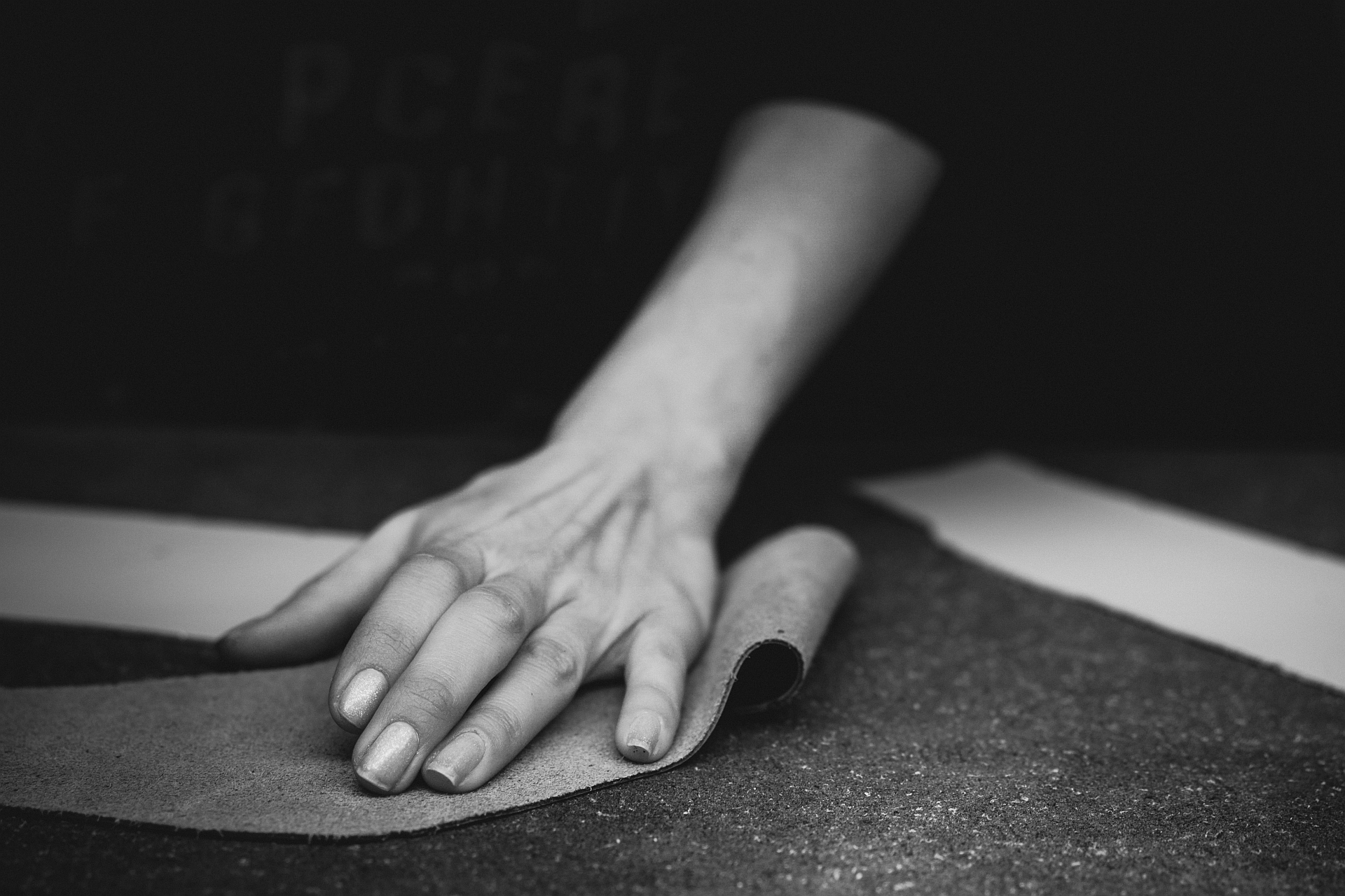 Pangea employee working with leather