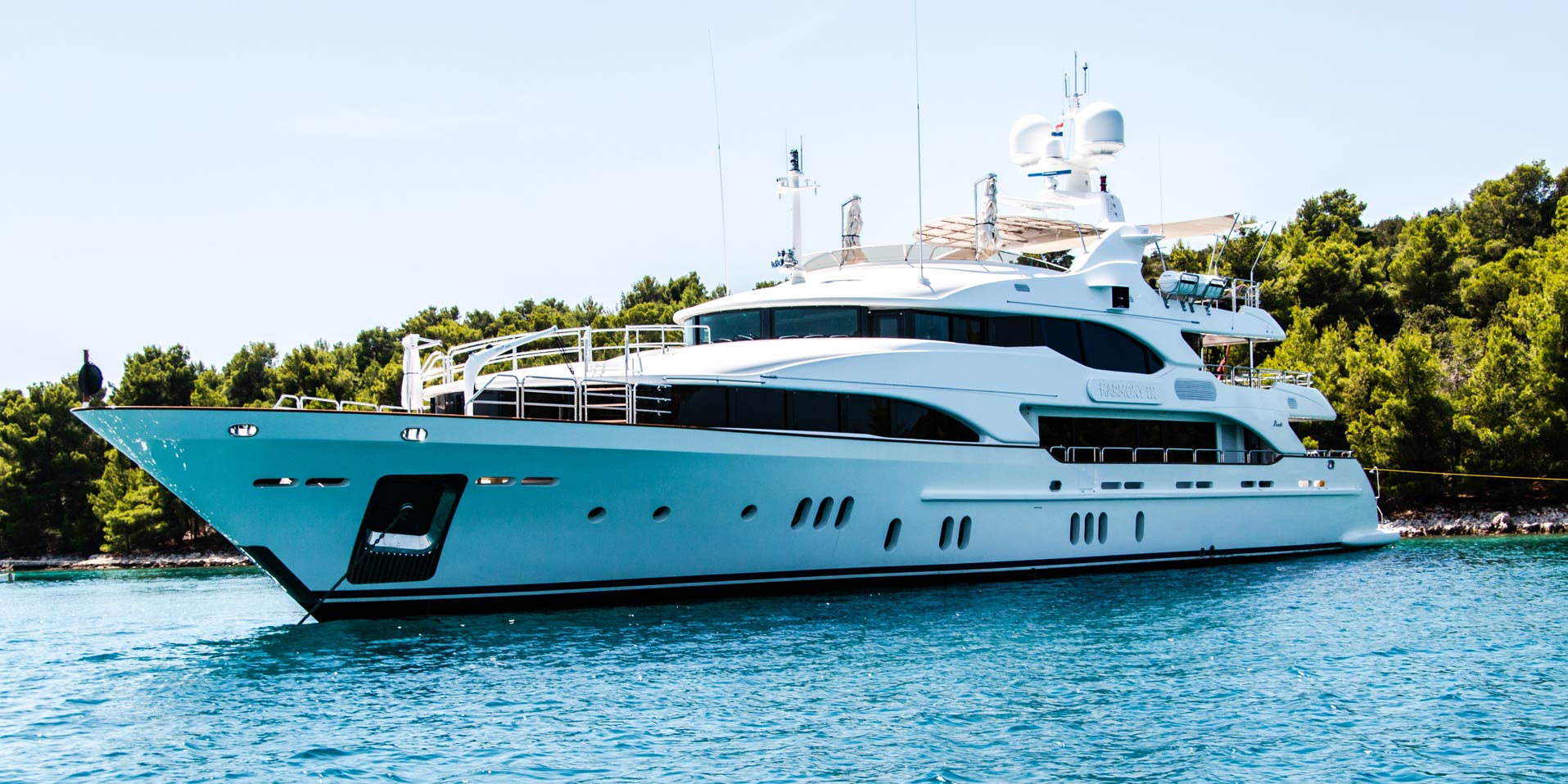 Yacht sitting on calm ocean water