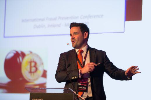 Aidan Larkin presenting at an event