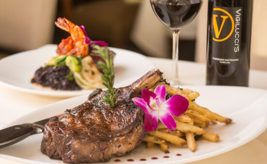Plate of steak and fries with a decorative edible flower.