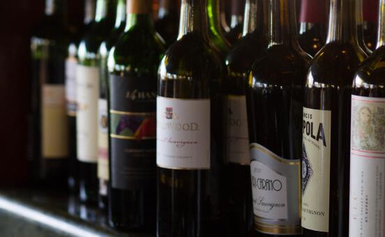 Shelf of wine bottles.