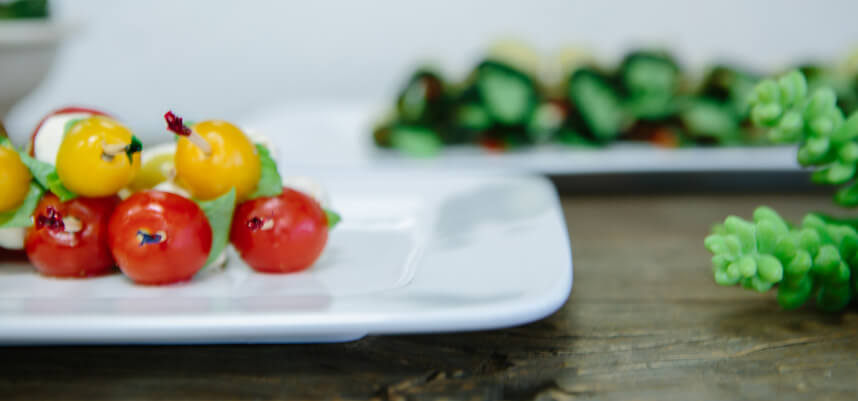 Assortment of plated vegetarian appetizers.