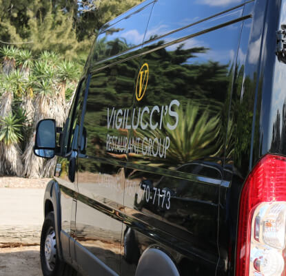 Vigilucci's catering van with the logo on the side.