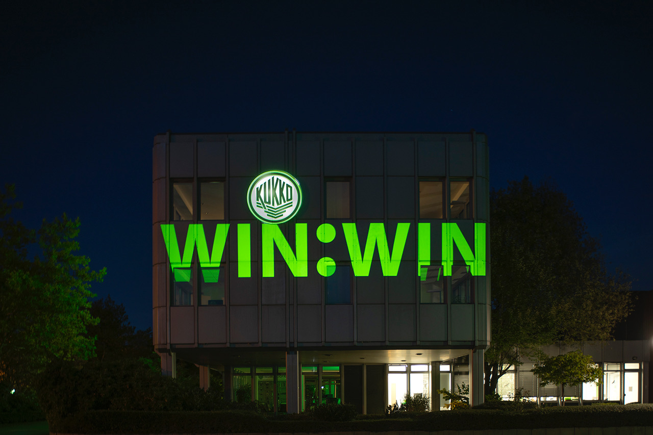 """The slogan """"WIN:WIN"""" is being projected on the KUKKO main facilities in Germany"""