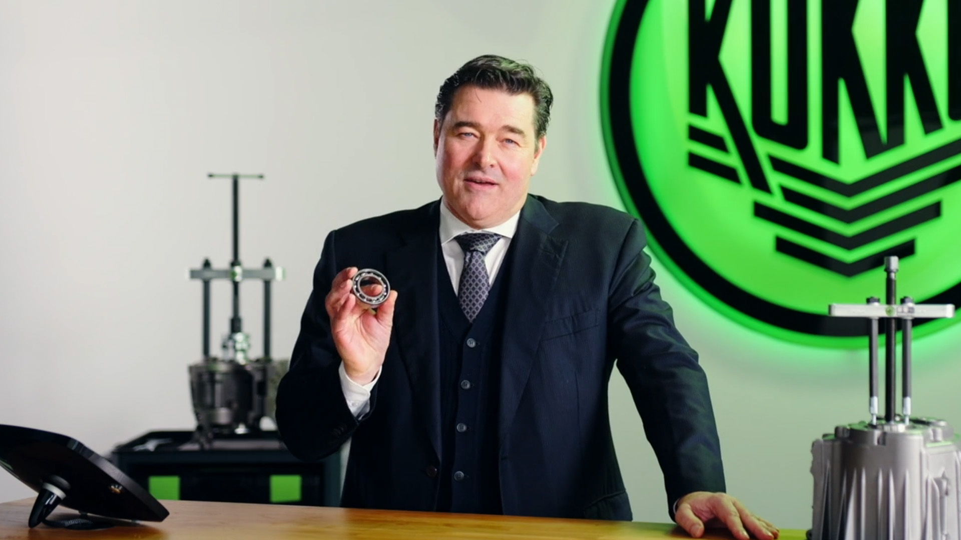 Ceo Michael Kleinbongartz holding a  ball bearing and explaining how to expand your bearing business.