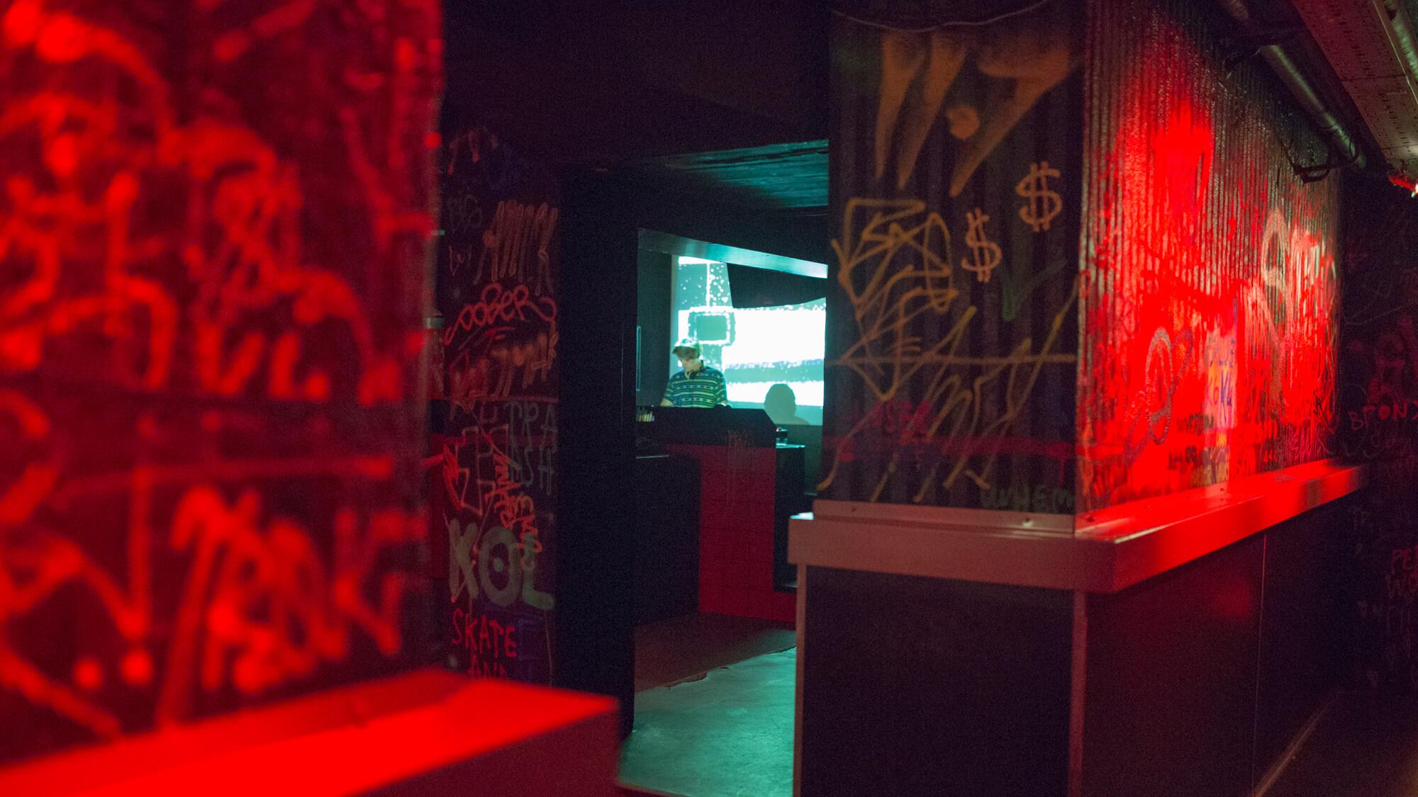 Graffiti walls on a dancefloor in club K4 in Ljubljana.