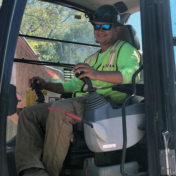 Operator in excavator doing his job