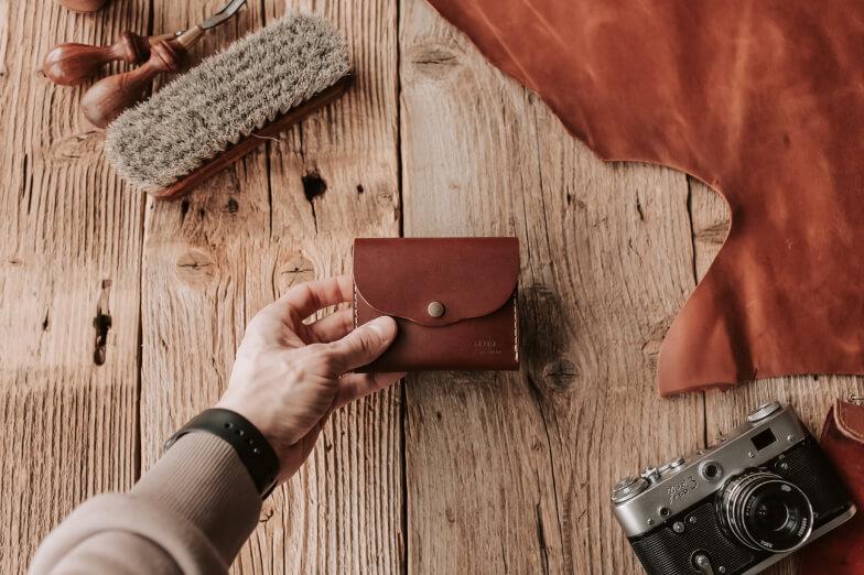 Man displaying a wallet