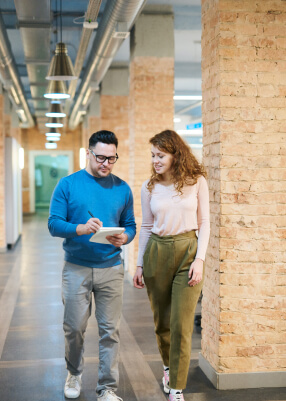 Man and a Woman looking at a notebook