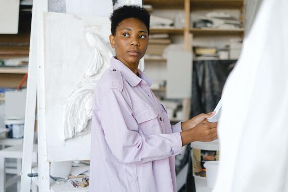 Woman touching a white fabric
