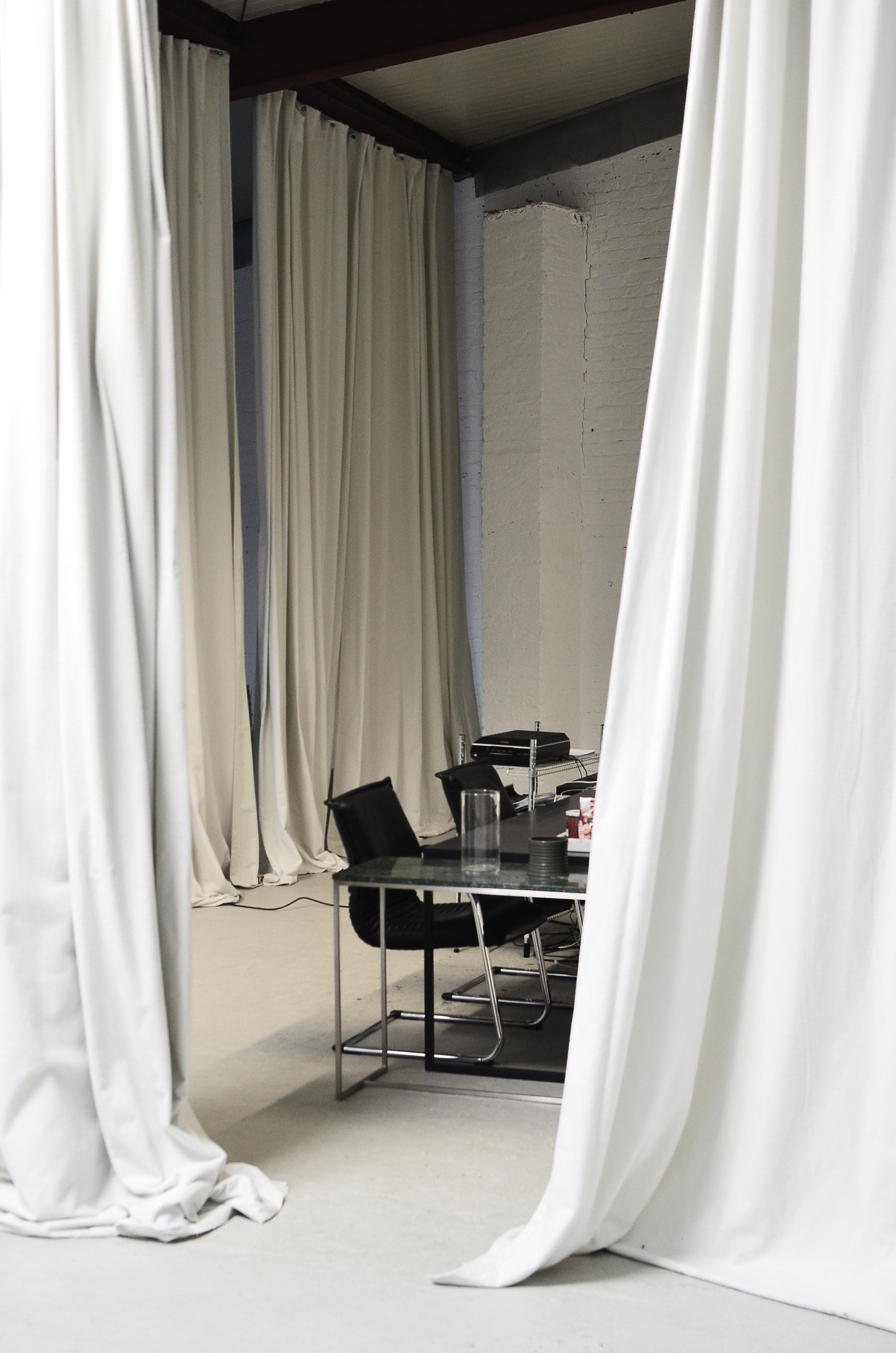 HQ office room surrounded by curtains
