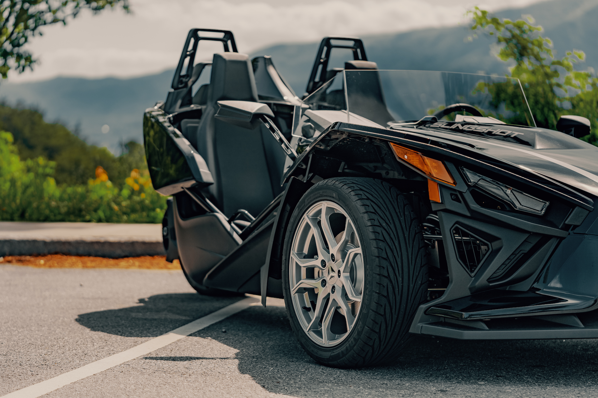 side cropped view of the Polaris Slingshot - Polaris Slingshots are available as rentals at the Mountain Mile Mall at Mountain Mile Adventures in Pigeon Forge, Tennessee