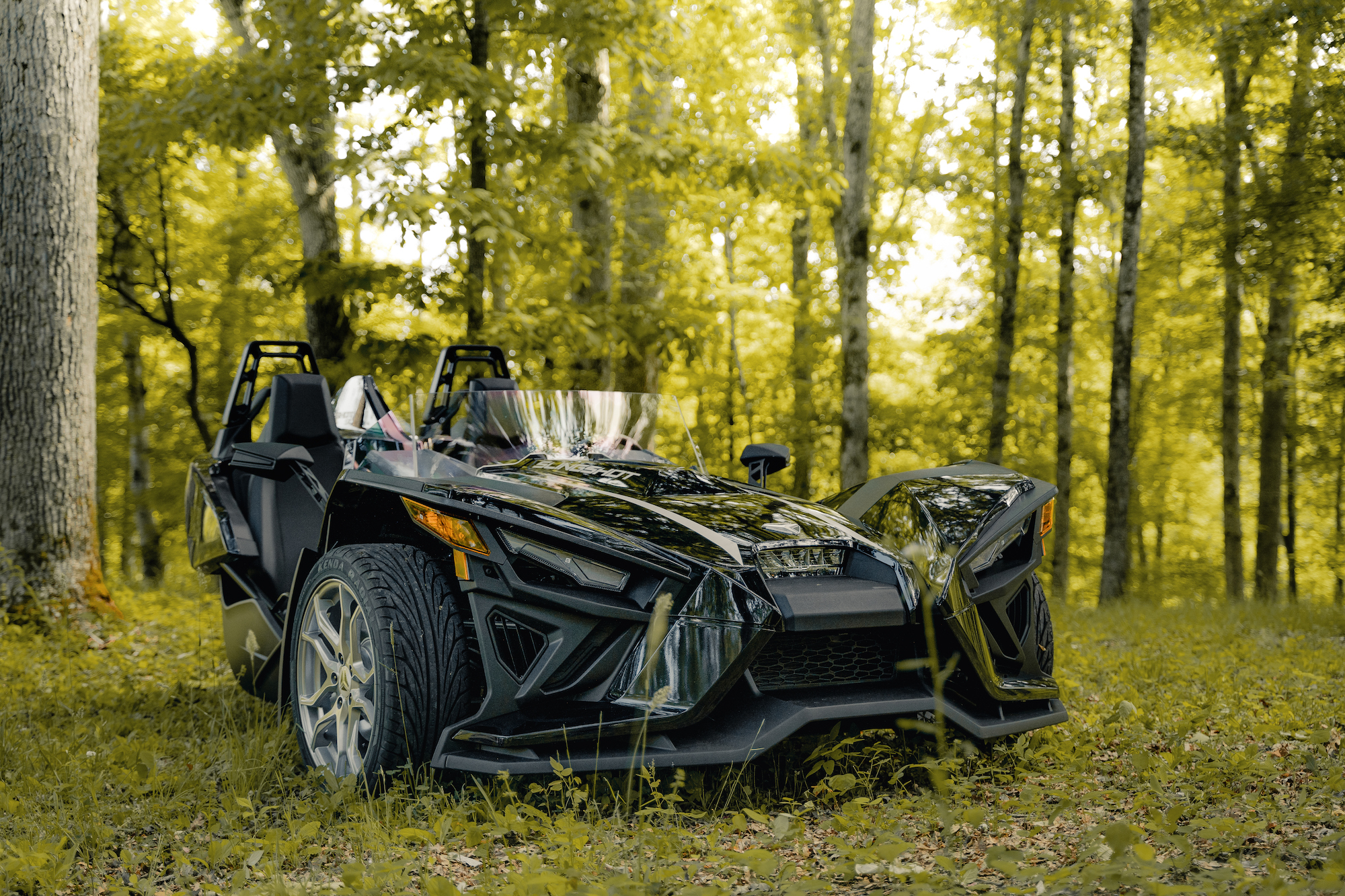 front of Polaris Slingshot - Polaris Slingshots are available as rentals at the Mountain Mile Mall at Mountain Mile Adventures in Pigeon Forge, Tennessee