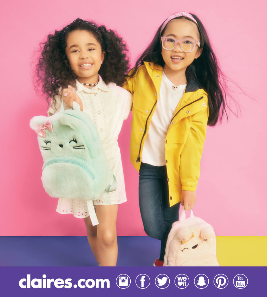 Two young girls with animal backpacks from Claire's