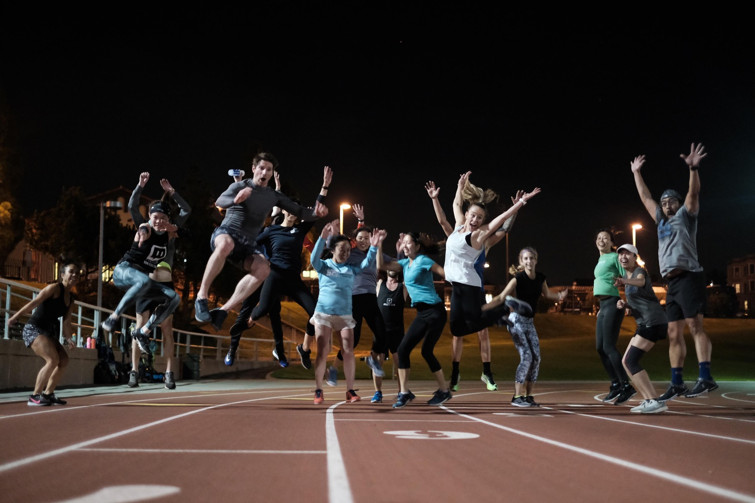 Image of Nth degree members jumping on the track.