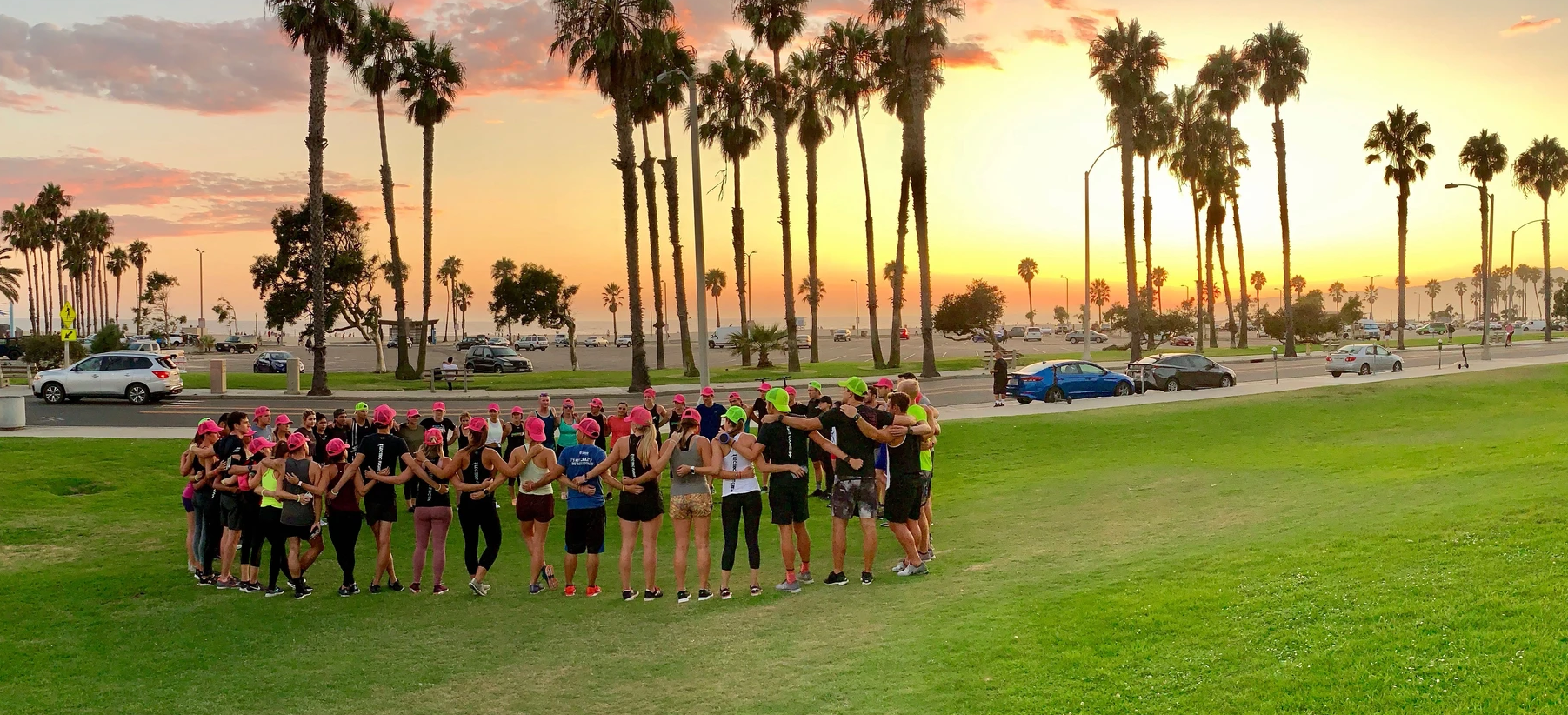 Image of Electric Athletic Club members huddling up before a run.