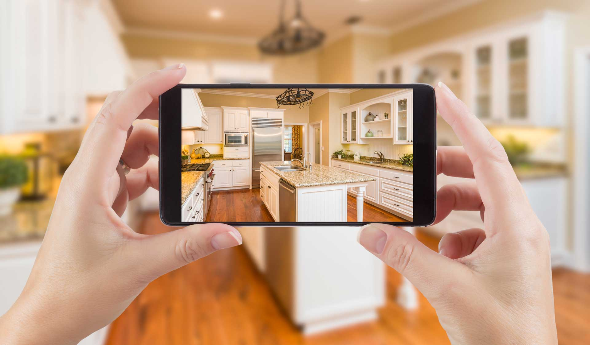 Someone taking a video of their kitchen via their mobile phone