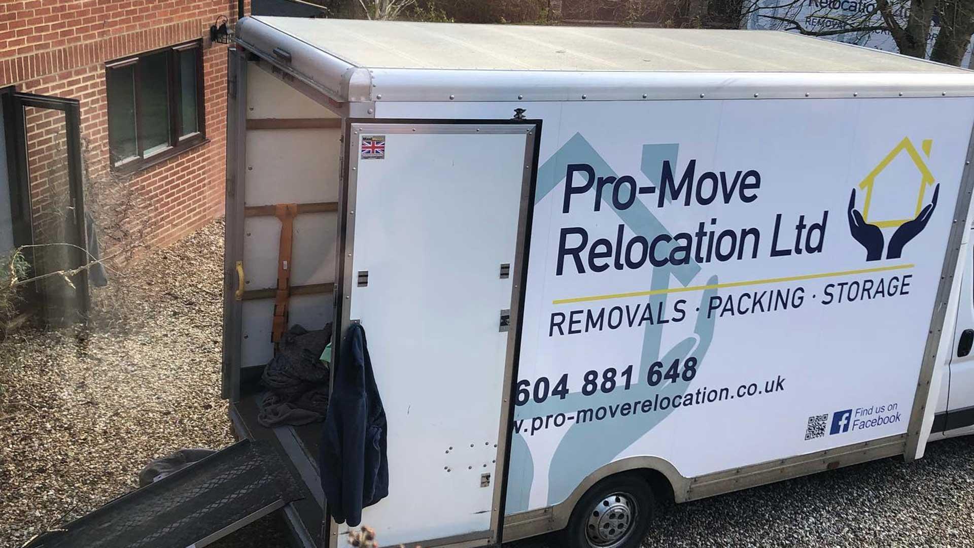 A Pro Move van on a shingle driveway