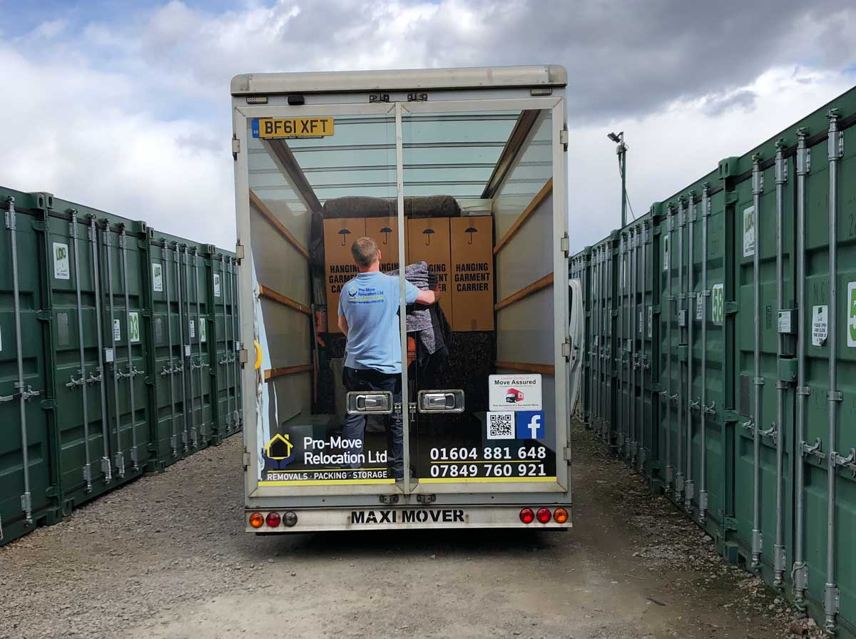 A Pro Move relocation van driving past some secure containers