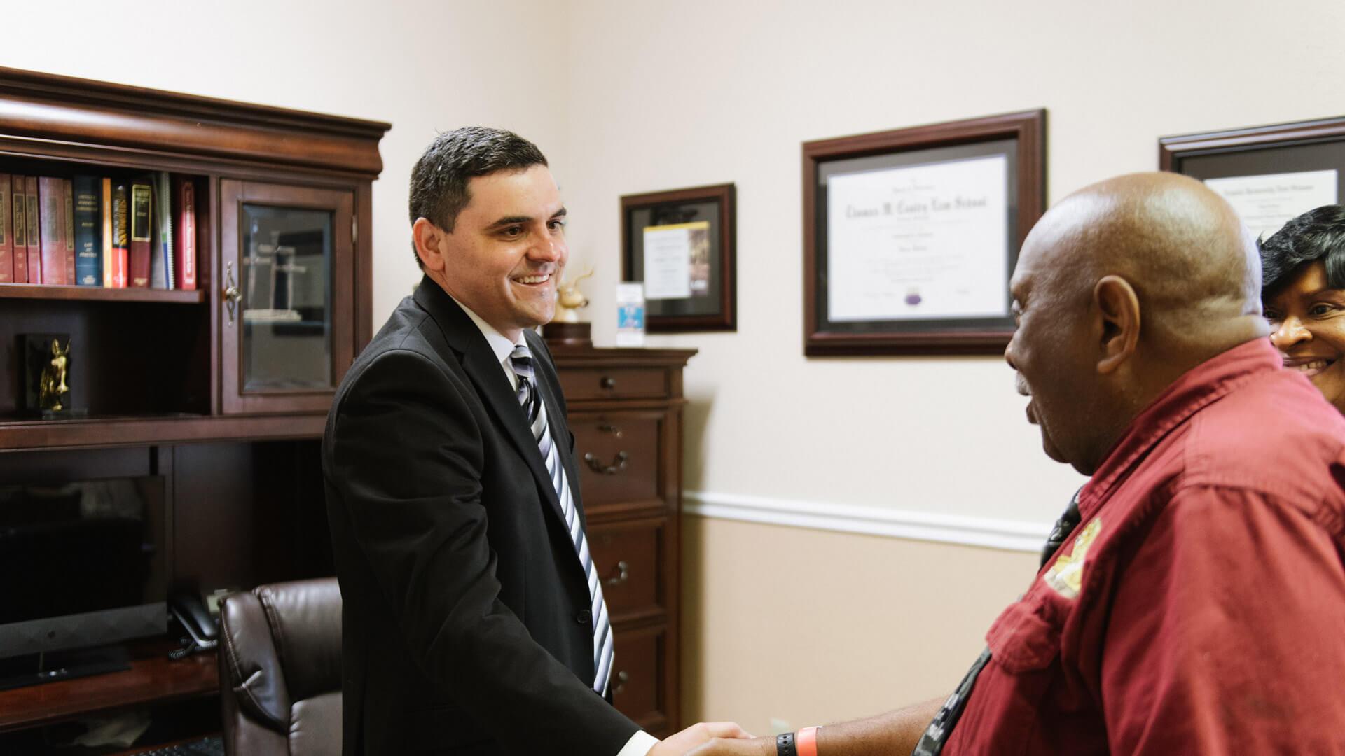 Chris Faucheux shaking hands with client