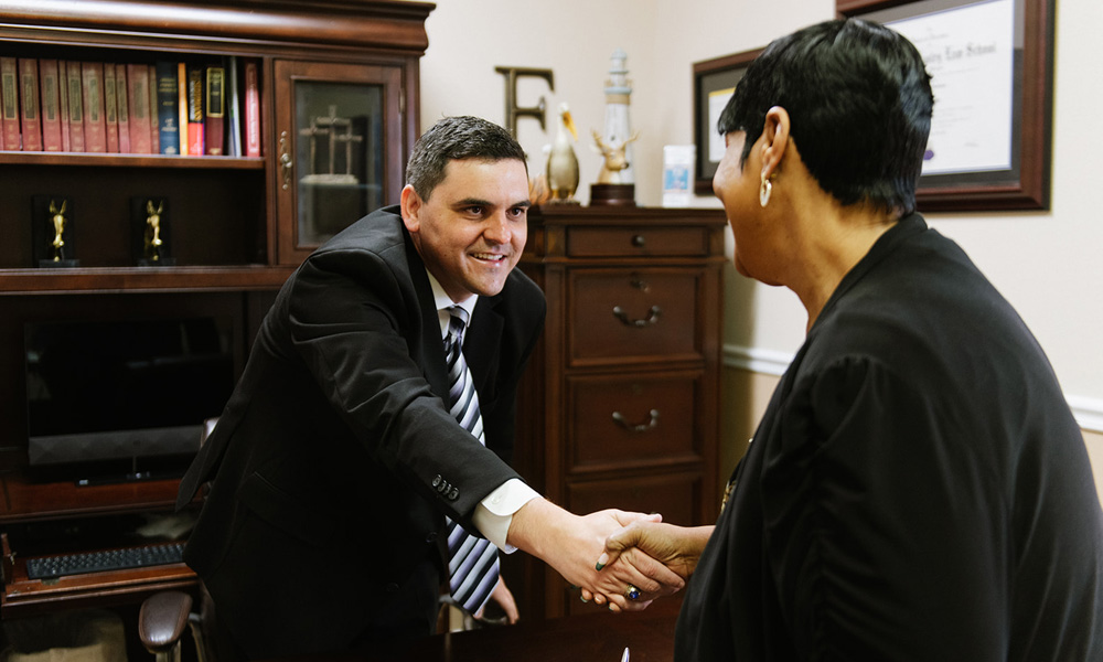 Chris Faucheux shaking hands with female client