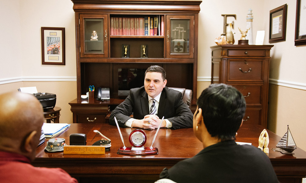Chris Faucheux sitting with clients in his office