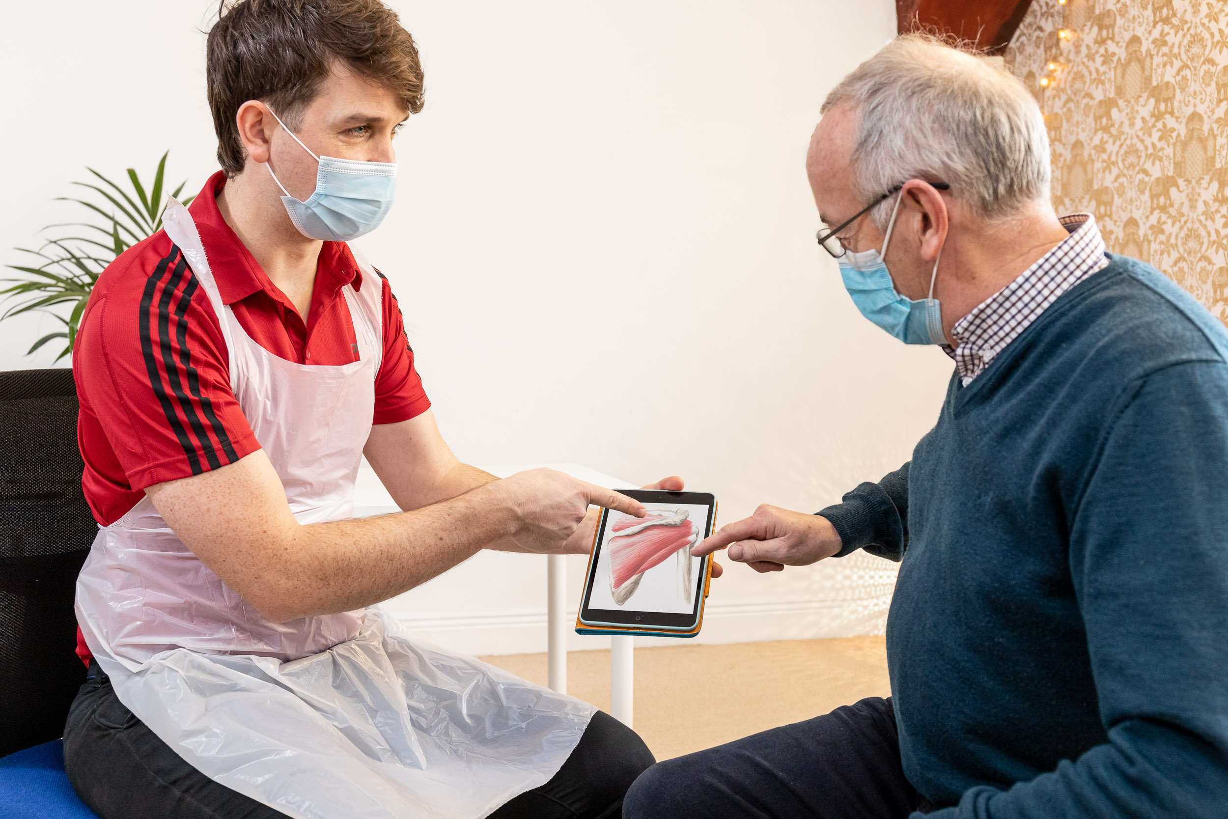 Stephen Gilman showing a mature man anatomy on a tablet