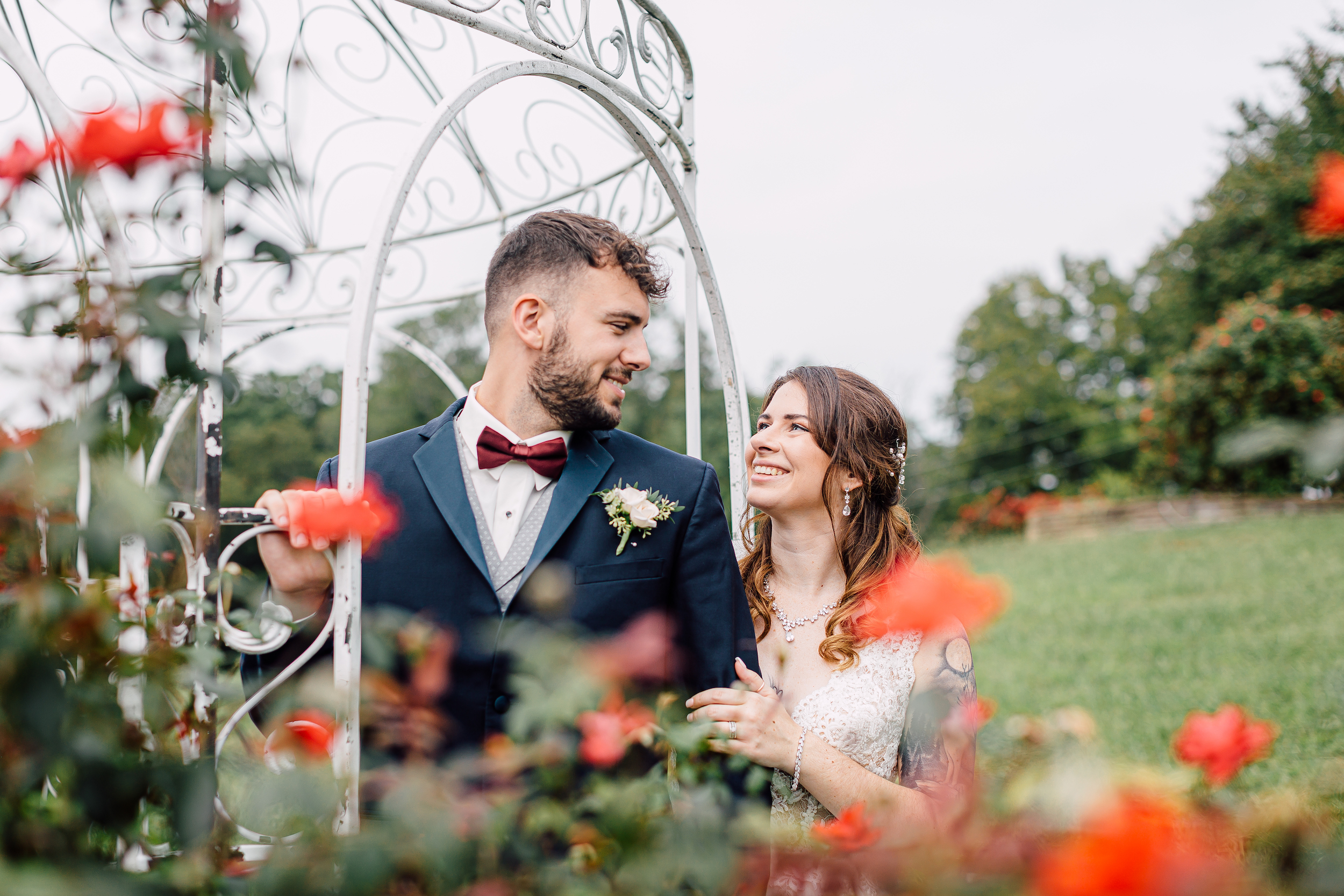 a couple outside surrounded by flowers at flower mountains wedding venue