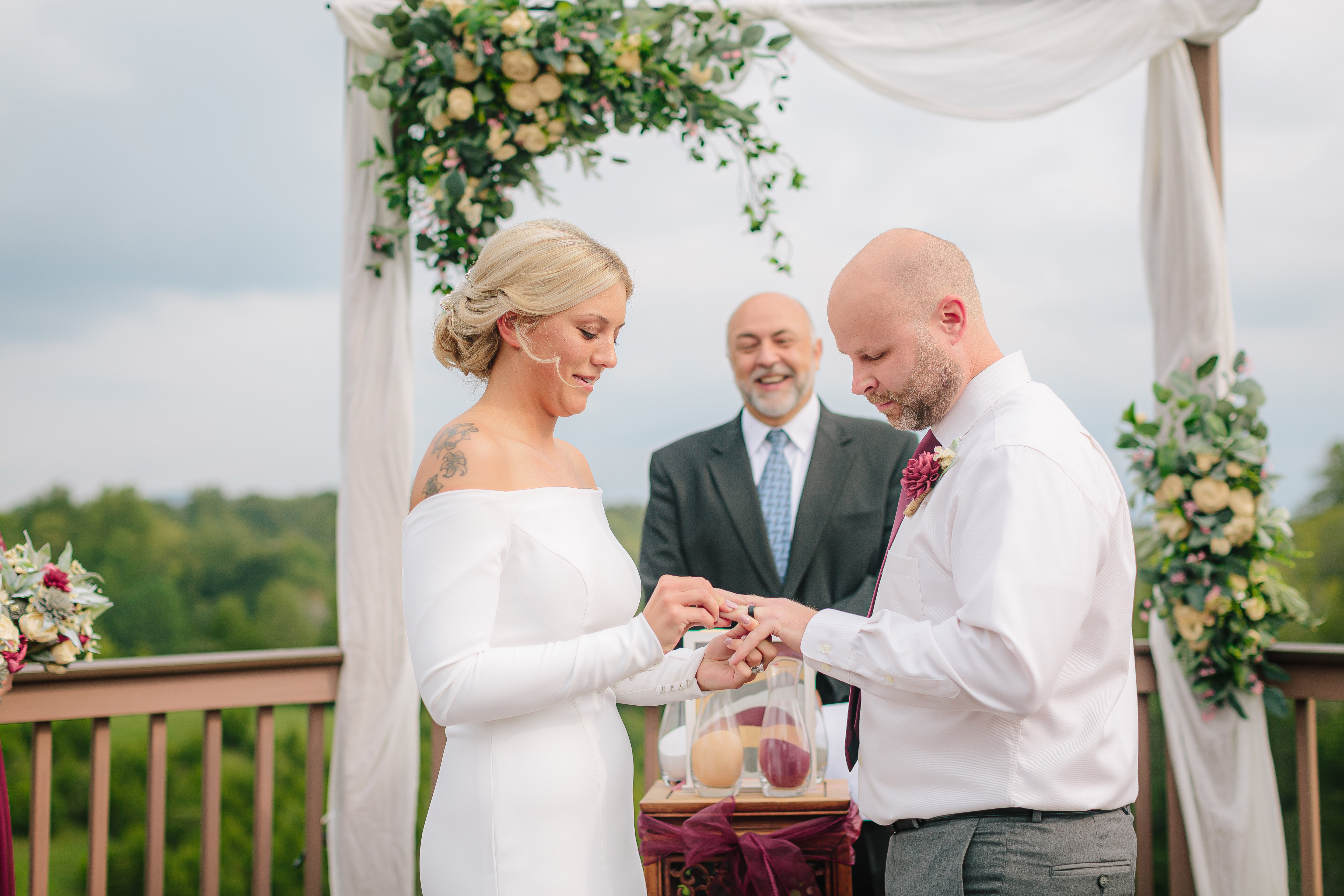 a couple getting married on the outdoor porch at flower mountains wedding venue
